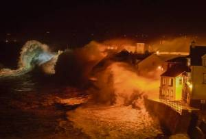 STORM FORCE: The raw power of the Atlantic captured as a barrage of waves batter the promenade in the coastal town of Lahinch in Co Clare. Photo: George Karbus